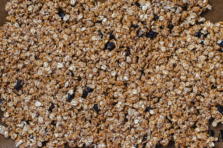 oatmeal cookie granola mixture spread out on tray before baking