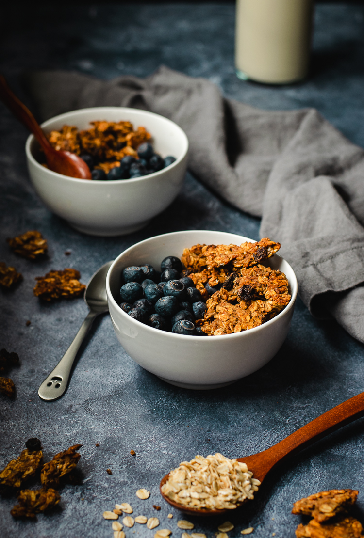 oatmeal cookie granola served in bowls with blueberries