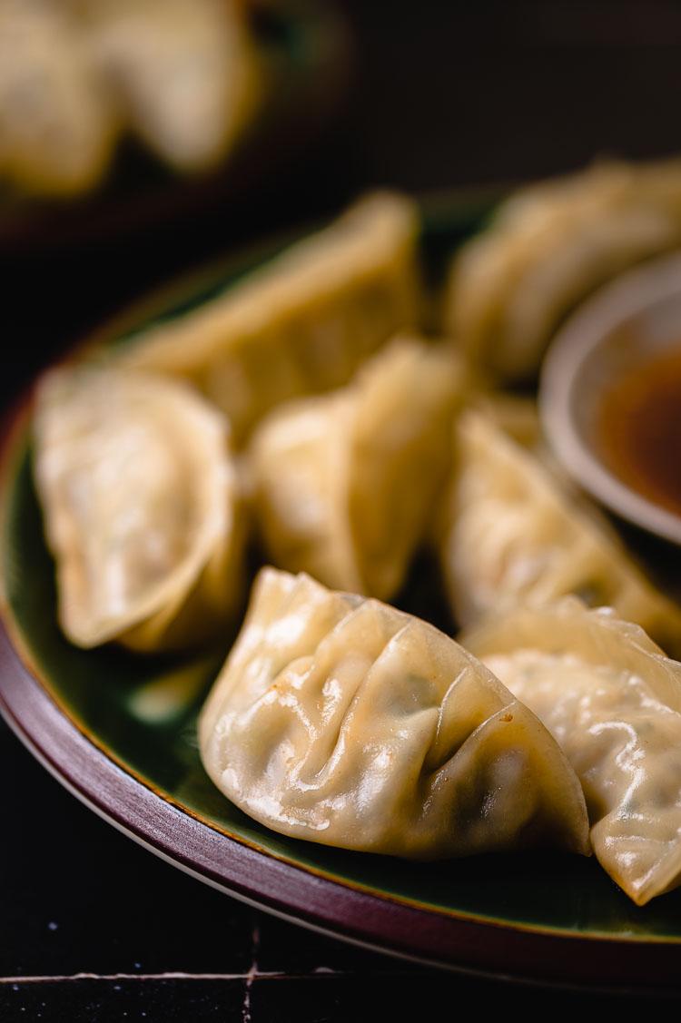 close up of a plate of gyoza
