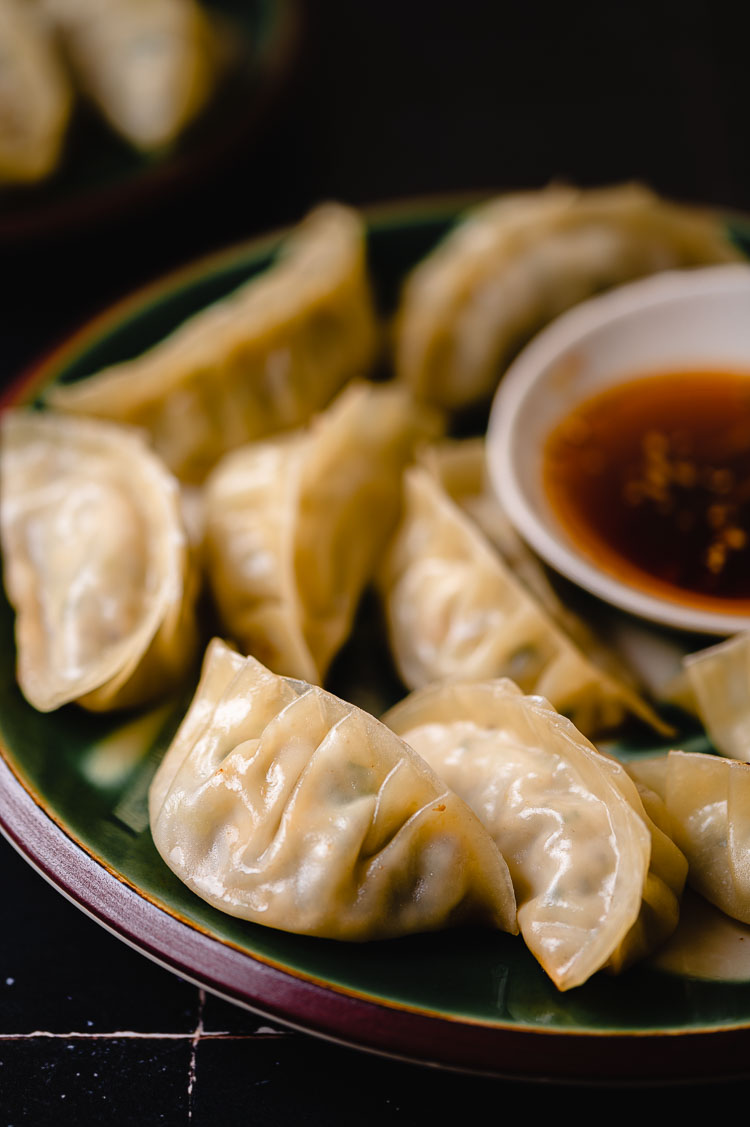 gyoza on a plate with dipping sauce