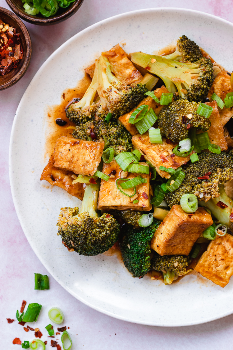 chili sauce tofu and broccoli served on a plate