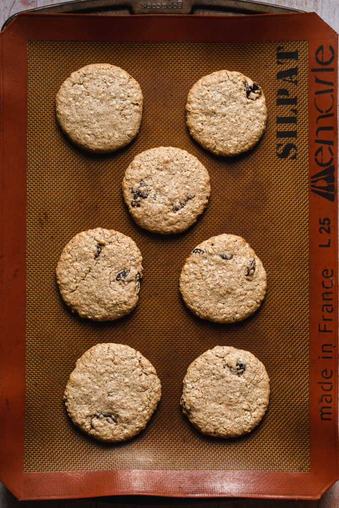 vegan oatmeal raisin cookies on baking sheet after baking