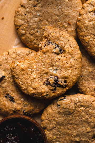 vegan oatmeal raisin cookie with a bite taken out of it
