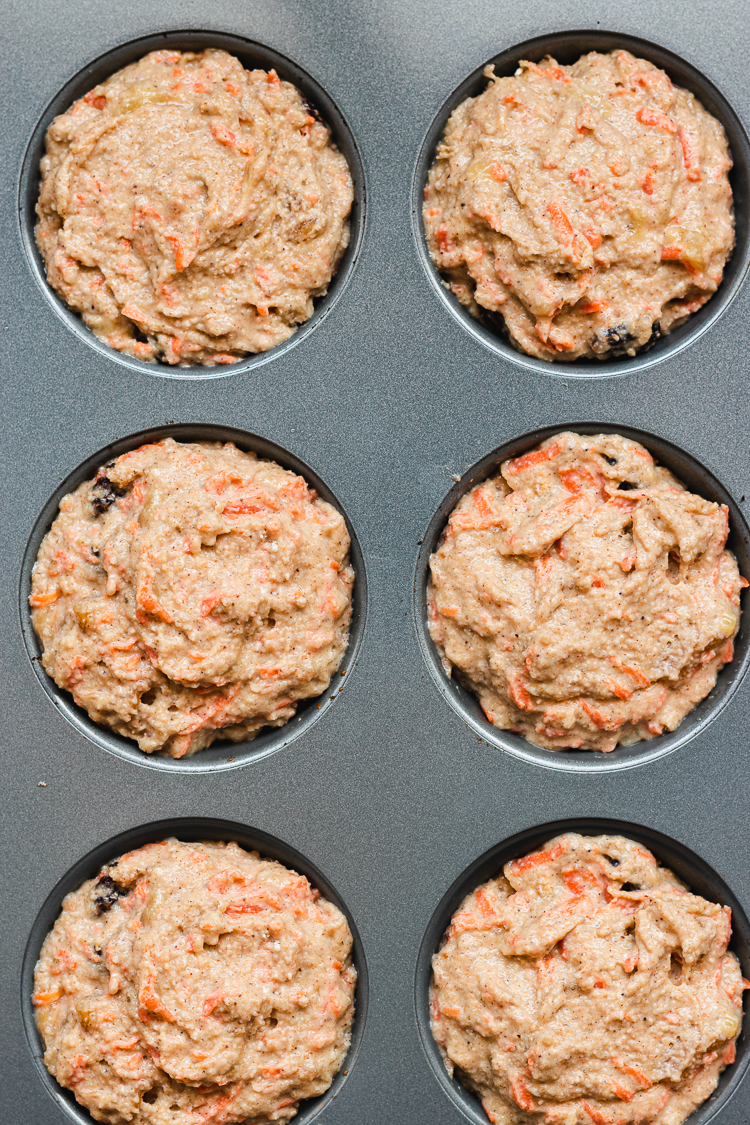 vegan carrot banana muffin batter in tray before baking