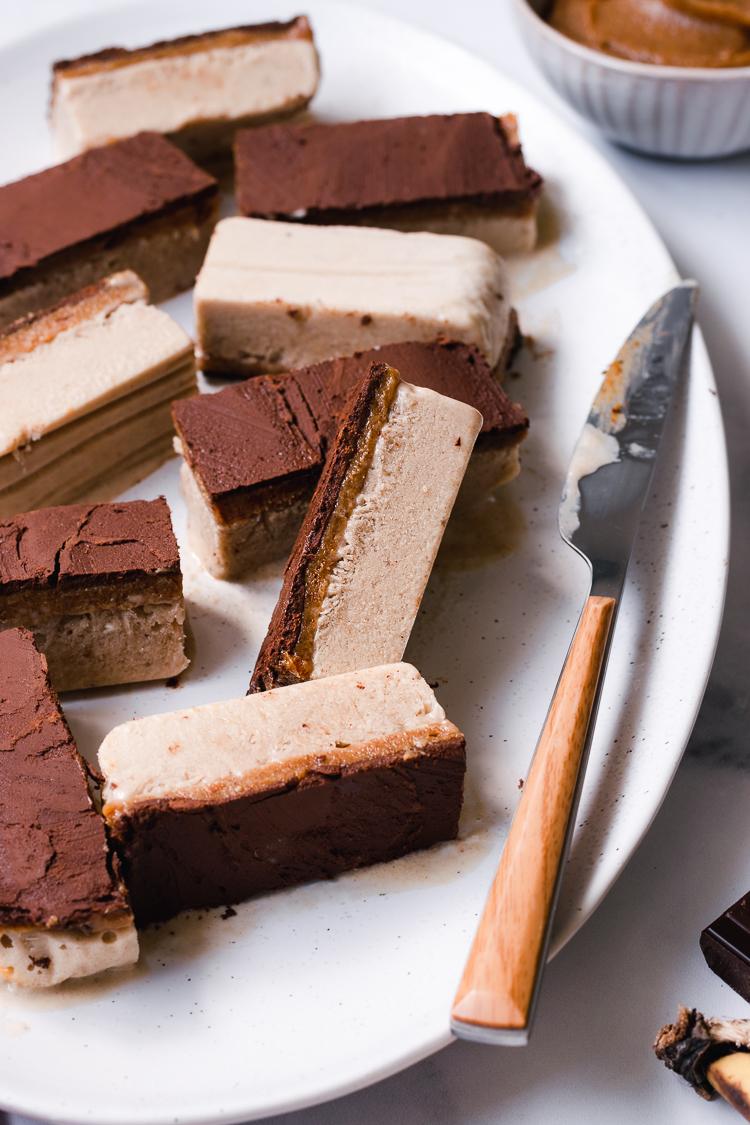 close up of vegan caramel ice cream bars on a plate