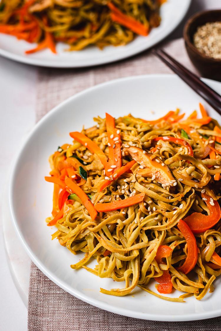 close up of edamame noodle stir fry on plate