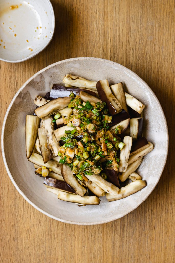 steamed eggplant with green onion dressing poured on top