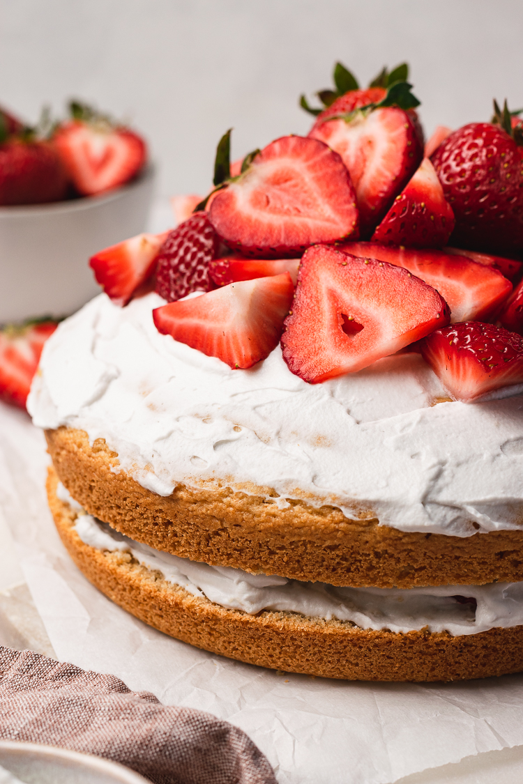 close up of vegan strawberries and cream cake
