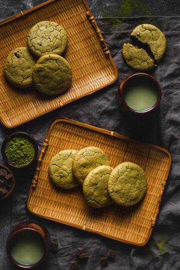 vegan matcha cookies arranged on platters, served with hot matcha tea