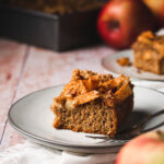 a piece of vegan apple crumb cake on a plate with a fork