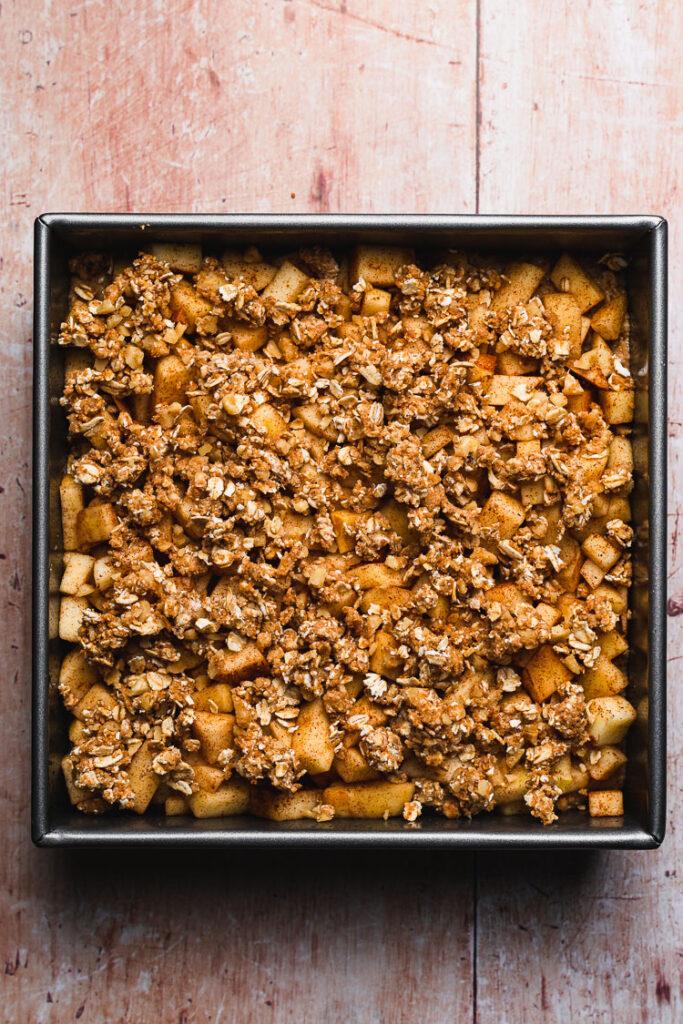 crumb topping added to vegan apple crumb cake prebaking