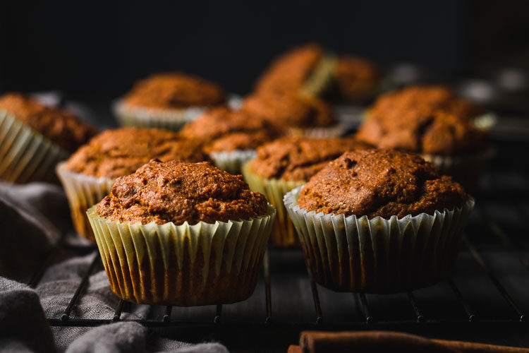 healthy vegan pumpkin muffins cooling on a rack