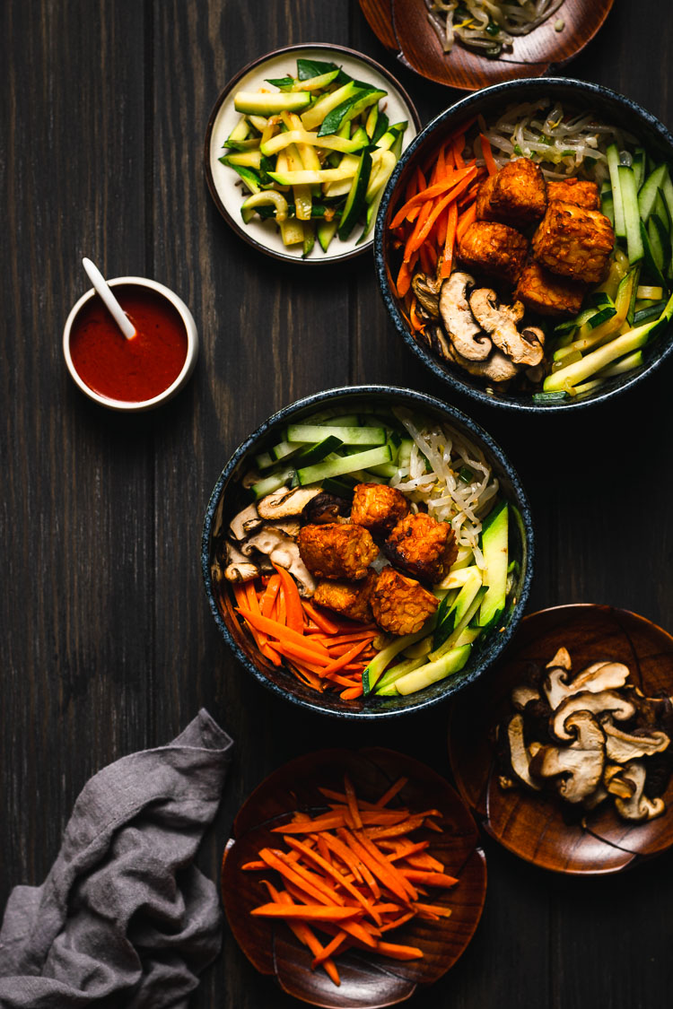 flat lay of two bowls of bibimbap with tempeh