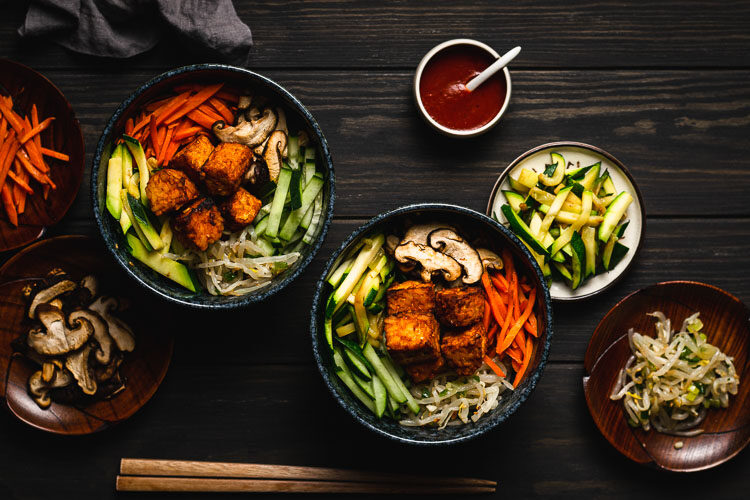 two bowls of bibimbap with tempeh