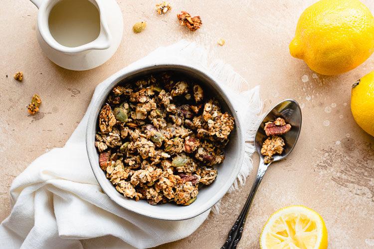 lemon tahini granola in a bowl flatlay