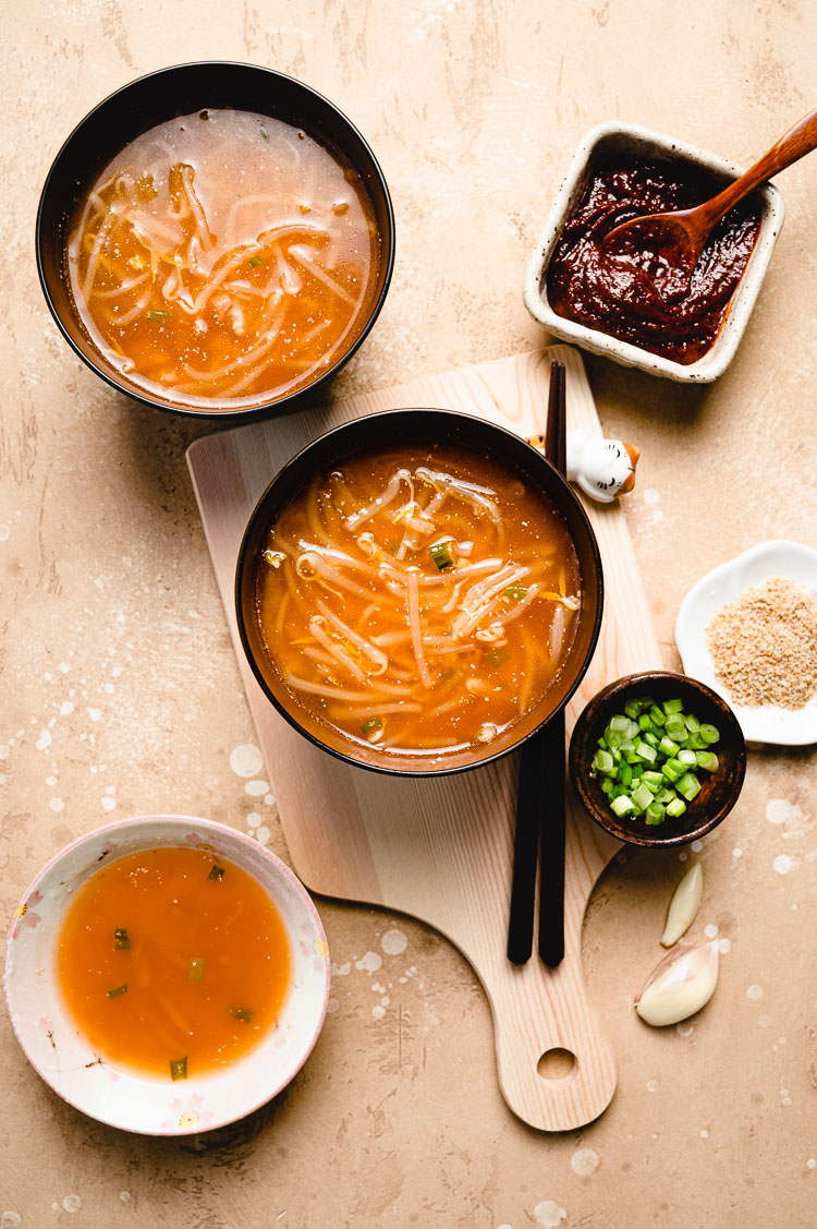 flatlay of 3 bowls of bean sprout miso soup