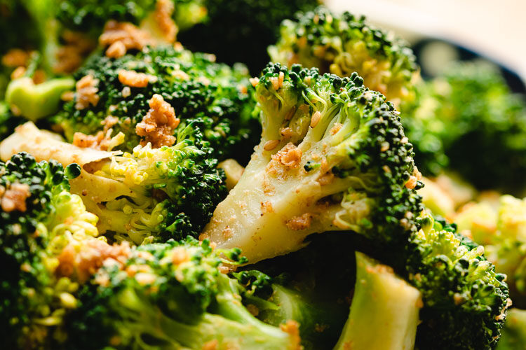 close up of broccoli gomaae on a plate